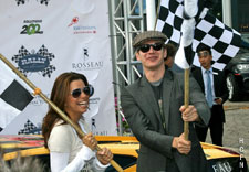 Hayden Christensen and Eva Longoria Parker raise the starters flags for the Rally for Kids with Cancer.