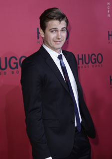 Hayden Christensen smiles for photographers on the red carpet at Berlin Fashion Week 2011.