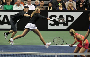 Hayden Christensen still holding hands with Aleksandra for the point after in mixed doubles match November 17, 2011 tennis.