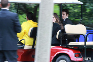 Hayden Christensen and Rachel Bilson are transported by gold cart to a wedding party for George Lucas and Mellody Hobson at Chicago's Promontory Point.