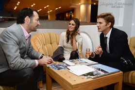 Hayden Christensen and Rachel Bilson chat with Nicholas Frankl at the launch of Glacier Films in Cannes.