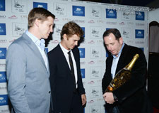 Jean-Christophe Rousseau makes a gold Jeroboam presentation to Hayden Christensen at the launch party for Glacier Films.