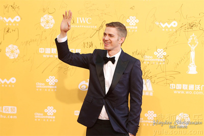 Actor and Producer Hayden Christensen waves to an enthusiastic crowd during opening ceremonies at the Beijing Film Festival, April 16, 2014.