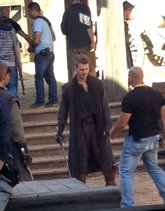 Hayden Christensen readies his broadsword with instruction from a stunt coordinator on the set of Outcast.