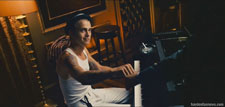 Hayden Christensen plays the piano in a scene from Takers