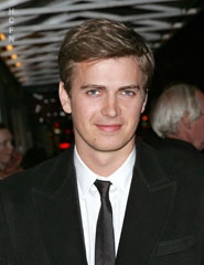 Hayden Christensen dressed for the cold in a longer style peacoat and Burberry suit.