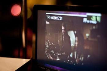 Hayden Christensen pictured on the monitor during film score recording.